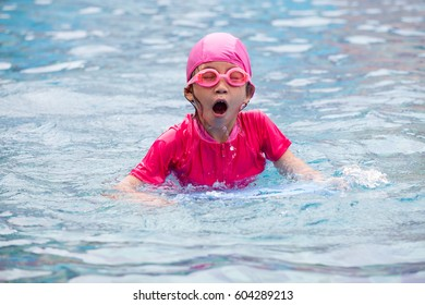 cute kids playing water sport games in pool