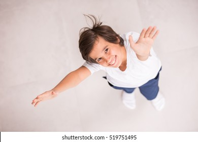 Cute kids posing from above angle on ground