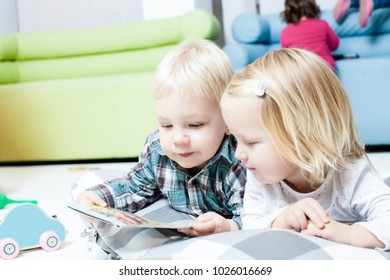 Cute kids review the book