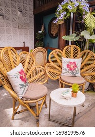 Cute kitsch cafe with wicker chairs and floral decorations in Hoi An, Vietnam