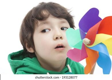 Cute Korean boy playing with pinwheel