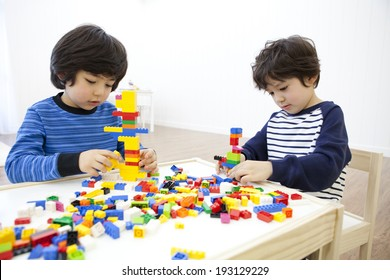 Cute Korean kids playing with lego