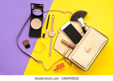 Cute ladies bag and feminine accessories . Flat lay, top view. Spring fashion concept.