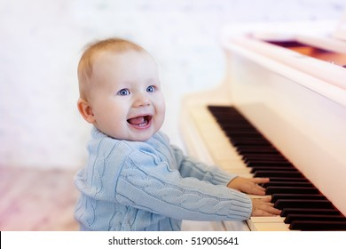 cute laughing baby playing the piano