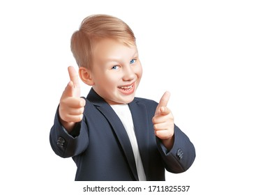 Cute laughing boy in a jacket and t-shirt pointing two finger guns at the camera isolated on a white background with copy space. Greeting friends, check out cool concept.