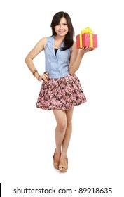 Cute laughing girl holding the red box present over white background