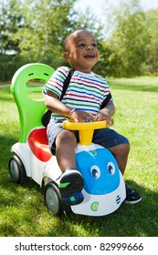 Cute little african american baby boy playing at park