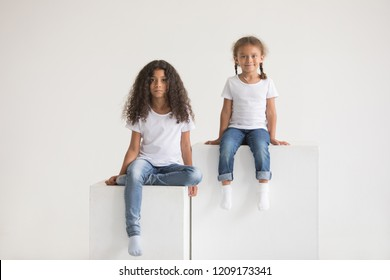 Cute little african american girls in white t-shirts. Mock-up.