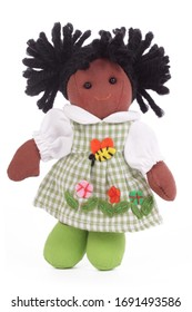 cute little african doll in rag on isolated white background