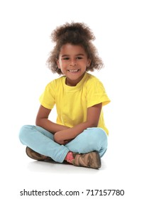 Cute little African girl on white background