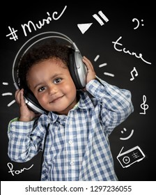 Cute little african-american boy with pleasure listening music, happy child wearing headphones, portrait over black background with different musical inscriptions