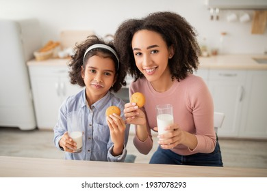 Cute Little Afro Girl And Her Mom Drinking Milk