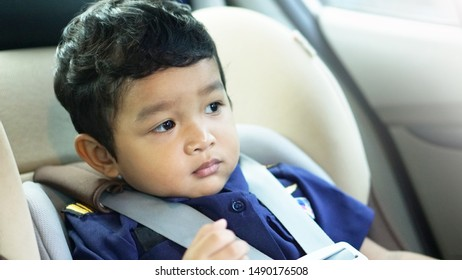 Cute little Asian 19 months / 1.7 year old toddler baby boy child sitting in car seat Happy traveling with child Little Traveler safety, road trip concept