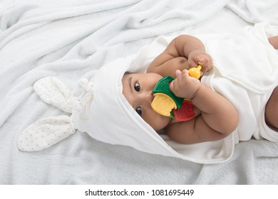 Cute little asian baby play teether