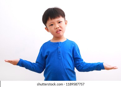 Cute little asian boy confused or doubting expression with his both palm facing up, isolated on white background.