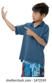 cute Little asian boy pointing at white space