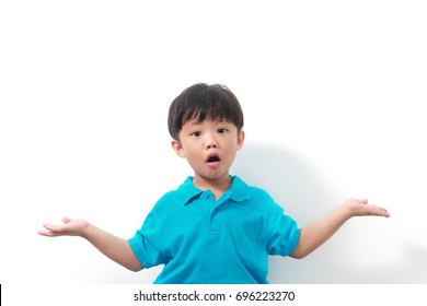 Cute little Asian boy showing curious expression with opening arm widely