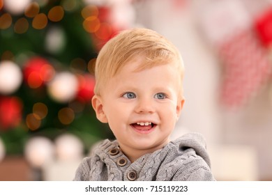 Cute little baby against defocused lights. Christmas concept