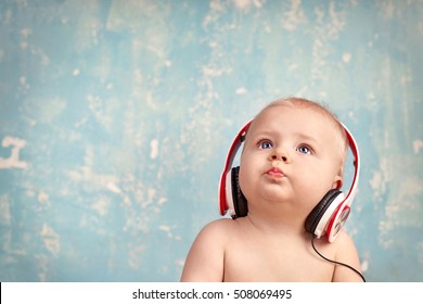 cute Little Baby Boy listening Music with head phones
