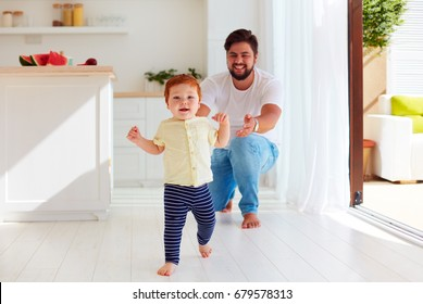 cute little baby boy making his first steps at home
