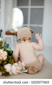 Cute little baby dressed as a bunny on Easter day.