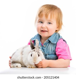 cute little baby and easter bunny on white background