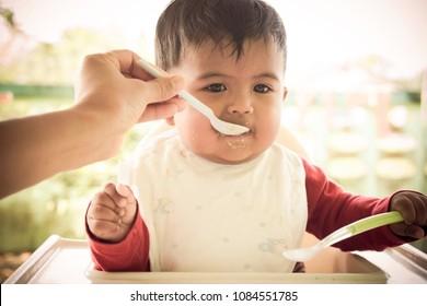 Cute little baby eating food,vintage tone
