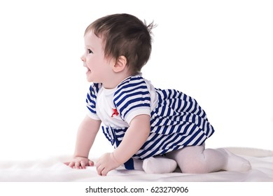 cute little baby girl in blue-white dress, crawling, laughing and playing at studio, isolated on white