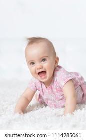 Cute little baby girl on white blanket