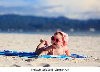 cute little baby girl on tropical sand beach