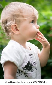 Cute little baby girl outdoors