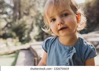 Cute little baby girl posing and smiling at camera