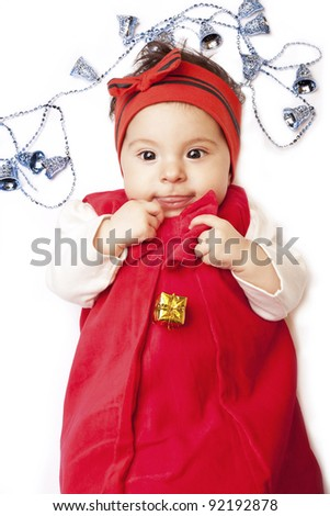 eb8ae4e881d cute little baby girl shows language in a red dress lying on a white  background with