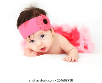 Cute little baby girl wearing a tutu and flower in her hair