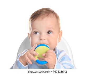 Cute little baby with nibbler on white background