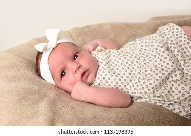 Cute little baby on bed at home