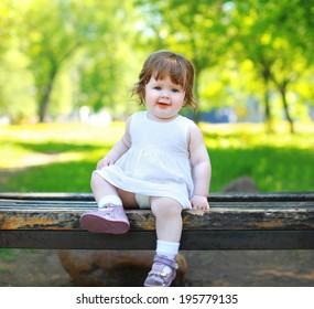 Cute little baby in summer park