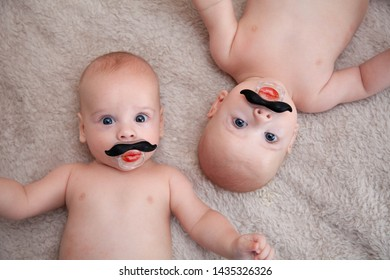 cute little baby twins relaxing on bed