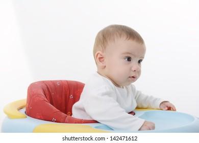 Cute little baby walking in walker