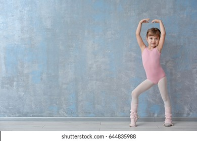 Cute little ballerina in dance studio