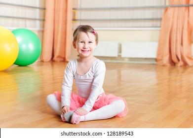 Cute little ballerina training at ballet class