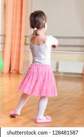 Cute little ballet dancer at training class