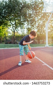 Cute little basketball player training on a outdoors court