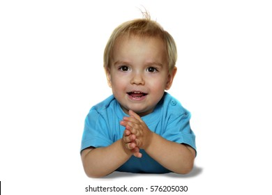 Cute little blond boy in blue T-shirt claps his hands isolated over white background, sign and gesture concept