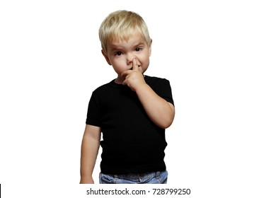 Cute little blond toddler boy in black T-shirt picking his nose, bad habits, childhood and family concept, emotional child portrait, isolated over white background, indoor closeup