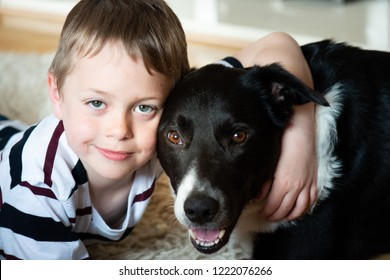 A cute little boy with ADHD, Autism, Aspergers Syndrome plays and poses with his loyal pet dog