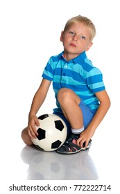 Cute little boy with the ball.The boy squats and holds the ball with his hands.Isolated on white background.