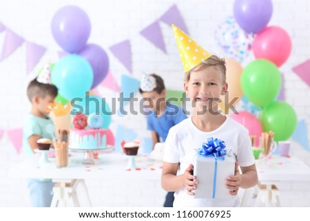 Cute Little Boy With Birthday Gift At Party