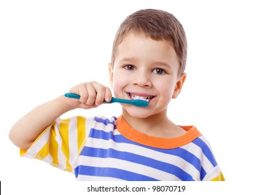 Cute little  boy brushing teeth, isolated on white