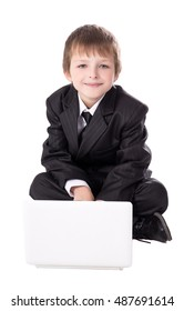 cute little boy in business suit with laptop isolated on white background